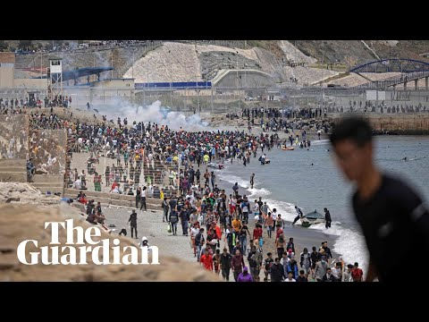 Migrants met by Spanish military as they swim to north African enclave Ceuta