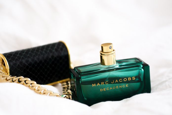 blue and gold perfume bottle